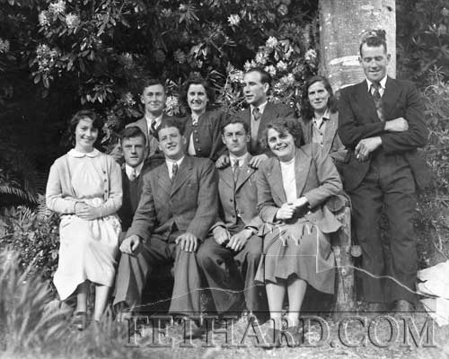 The names we have so far are Back L to R: unknown, Bridget Malone, John Collins, Mary Nagle, unknown, Front L to R: Rena Purcell, Tom Butler, Batt Toomey, Willie Slattery and unknown. Can you help identify the 'unknowns' ?